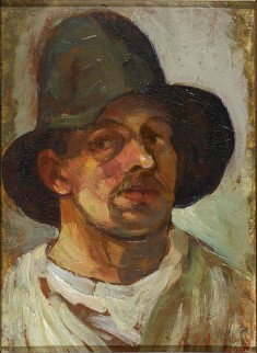 Theo_van_Doesburg_Selfportrait_with_hat